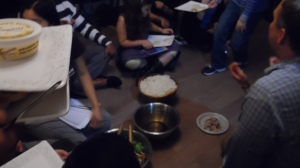 At a Hunger Banquet, the low-income participants sit on the floor.